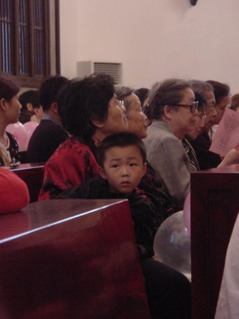 child in worship